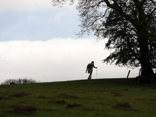 Person Walking up hill.