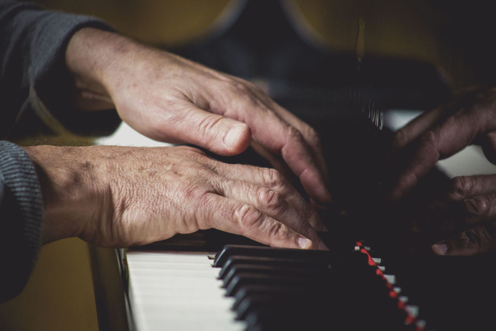 Hands Playing Piano.