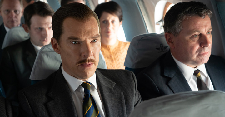 Benedict Cumberbatch Sitting On A Plane With Five People.