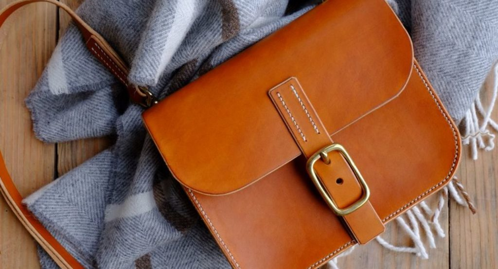 Mini Leather Satchel Lay On A Scarf.