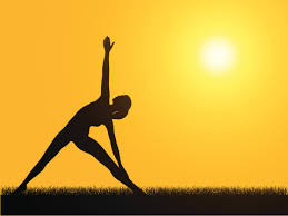 Silhoutte Of A Person Doing Yoga In Front Of A Sunset